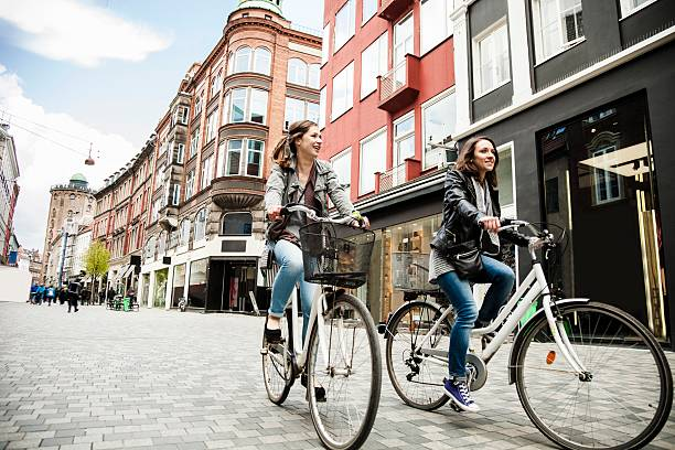 women cycling in copenhagen - denmark stock photos and pictures