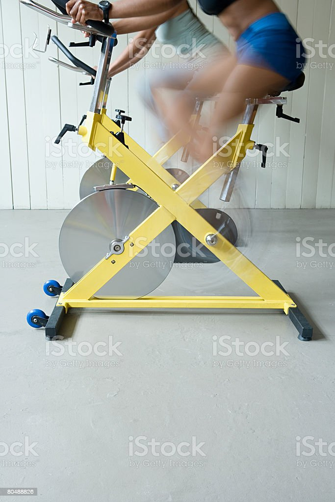 Women cycling on exercise bikes royalty-free stock photo