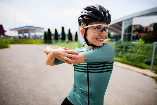 Women cyclist is stretching before riding session