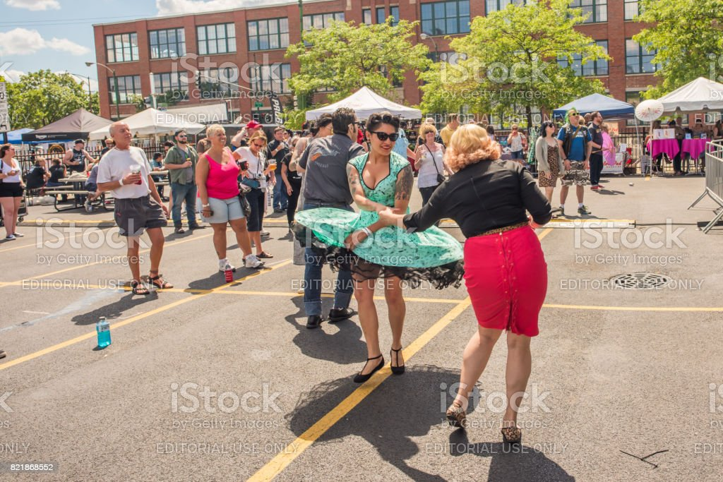 Women dancing in vintage clothing at a street fest in Chicago stock photo