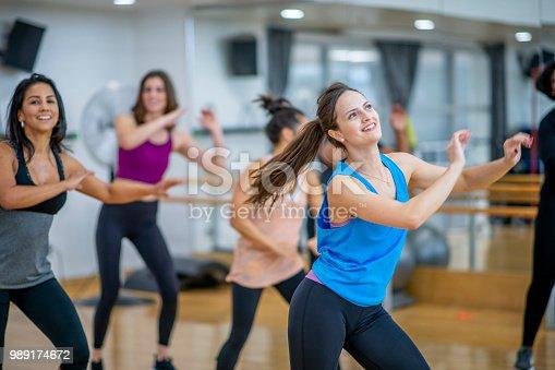 897892972 istock photo Women Dancing 989174672
