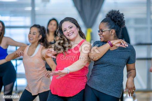 897892972 istock photo Women Dancing Together 998835588
