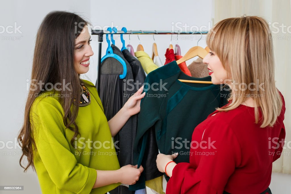 women deciding what to wear stock photo