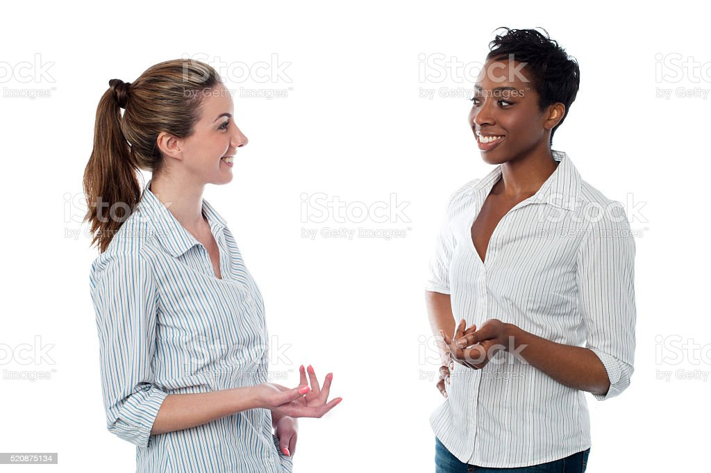Women discussing something casually stock photo