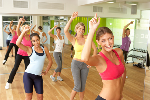 Women Doing A Fitness Class In Gym Stock Photo - Download Image Now
