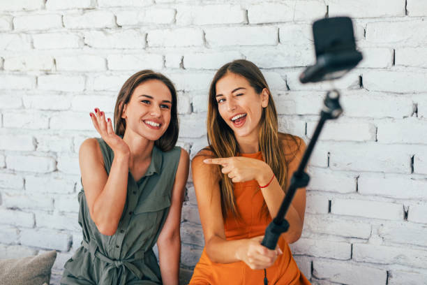 Women doing a vlog stock photo