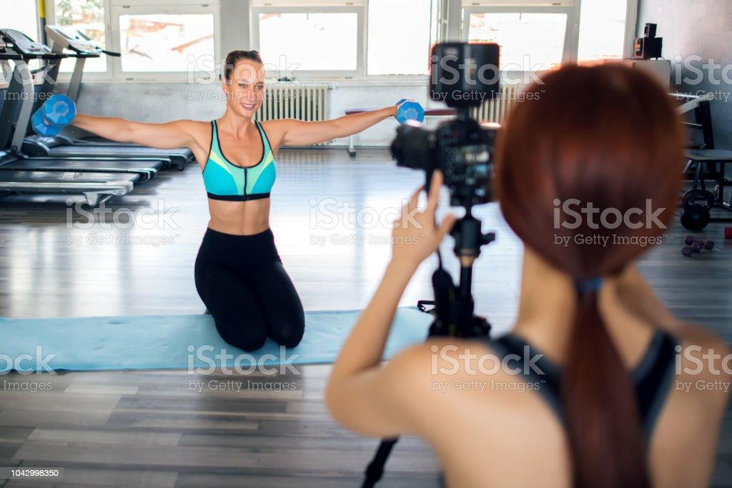 Women doing an exercise vlog stock photo