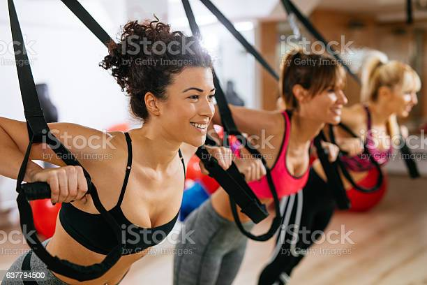Women doing arm exercises with suspension straps at gym picture id637794500?b=1&k=6&m=637794500&s=612x612&h=o1cnoax5gmzmnhiu9iiwd20dbwua48niqhzcywgtydk=