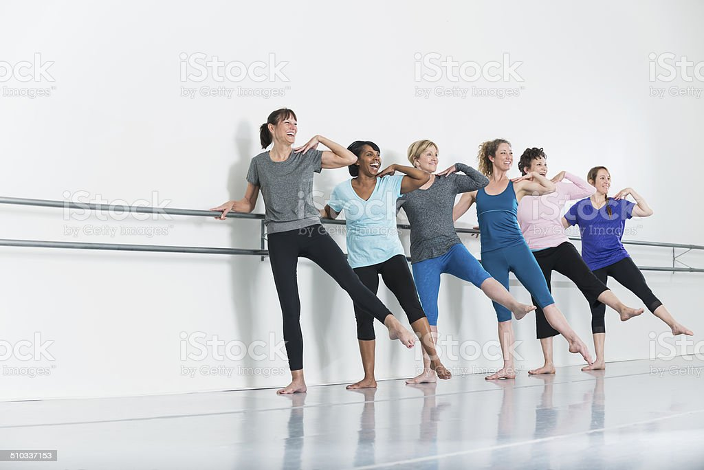 Women doing barre exercises stock photo