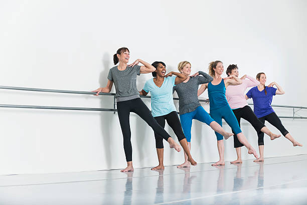 women doing barre exercises - gym skratt bildbanksfoton och bilder