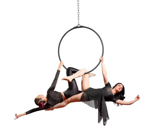 Women doing gymnastic exercises on the hoop stock photo