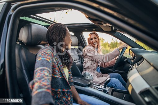 812419994istockphoto Women doing on a road trip 1179359529