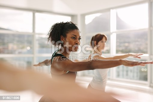 istock Women doing stretching and yoga workout at gym 918621696