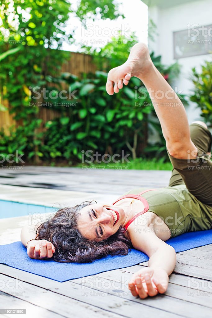 Women doing yoga on the street stock photo
