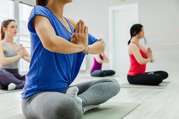 Women Doing Yoga stock photo