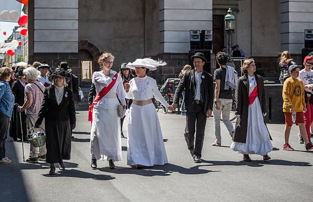 Women dressed as suffragettes, Copenhagen, Denmark Сopenhagen, Denmark - June 5, 2015: Women dressed as suffragettes. June 5, 2015 Denmark celebrates the centenary of the revision of the Danish constitution (from 1849) which gave women the right to vote and to participate in the democratic process. women's suffrage stock pictures, royalty-free photos & images
