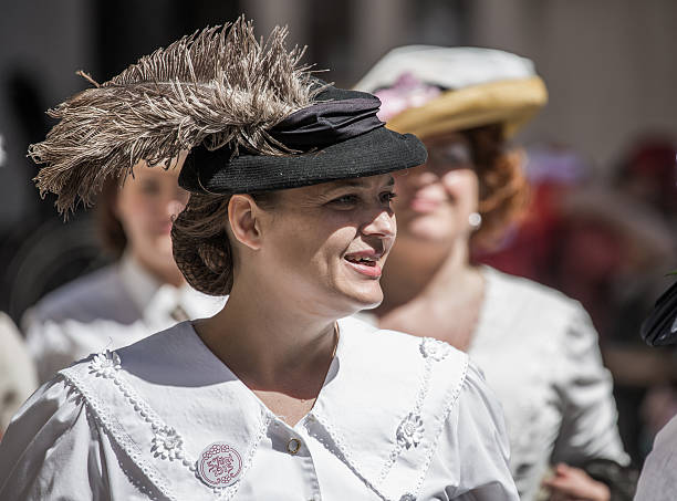 Women dressed as suffragettes, Copenhagen, Denmark Сopenhagen, Denmark - June 5, 2015: June 5, 2015 Denmark celebrates the centenary of the revision of the Danish constitution (from 1849) which gave women the right to vote and to participate in the democratic process. suffragist stock pictures, royalty-free photos & images