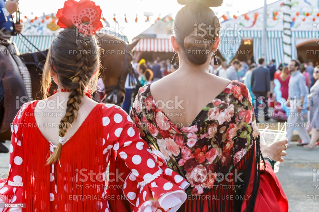 4c8d590f1 Seville, Spain - May 03, 2017: Women dressed in traditional costumes at the  Seville's April Fair. - Stock image .
