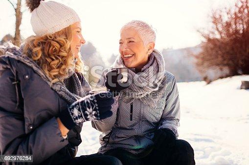istock Women Drinking Tea Outdoors At Winter 692976284