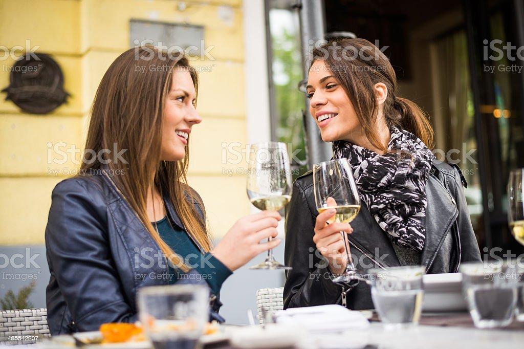 Women drinking white wine royalty-free stock photo
