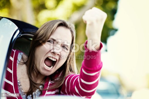 1138361116 istock photo Women drivers get road rage too! Furious female shaking fist 510356955