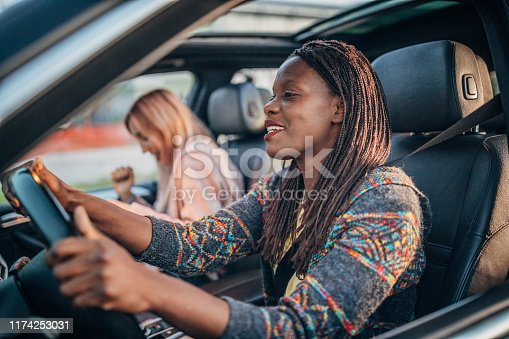 812419994 istock photo Women driving in a car 1174253031