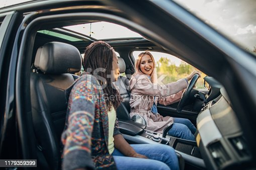 812419994 istock photo Women driving in a car 1179359399