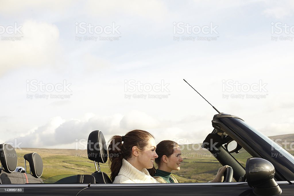 Women driving in rural landscape stock photo