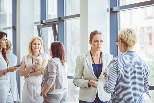 Women During A Break In Seminar Stock Photo - Download Image Now