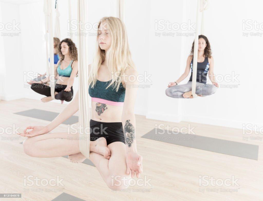 Women during aerial yoga class stock photo