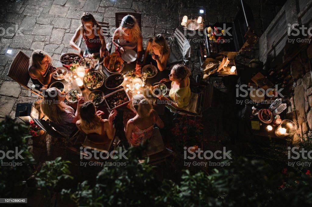 Women Eating Al Fresco in Tuscany stock photo