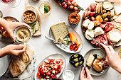 istock Women eating fresh Mediterranean platter on table 1224986971
