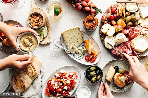 istock Women eating fresh Mediterranean platter on table 1224986971