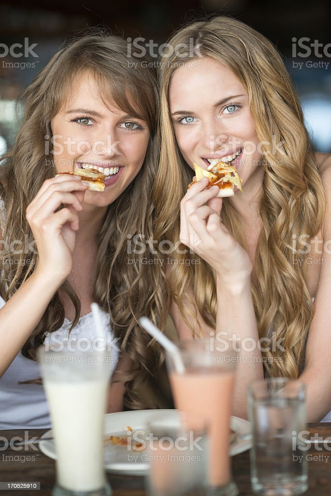 Women eating Pizza royalty-free stock photo