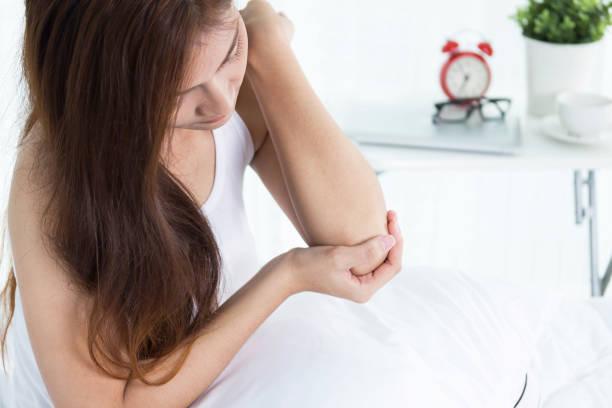 women elbow pain stock photo