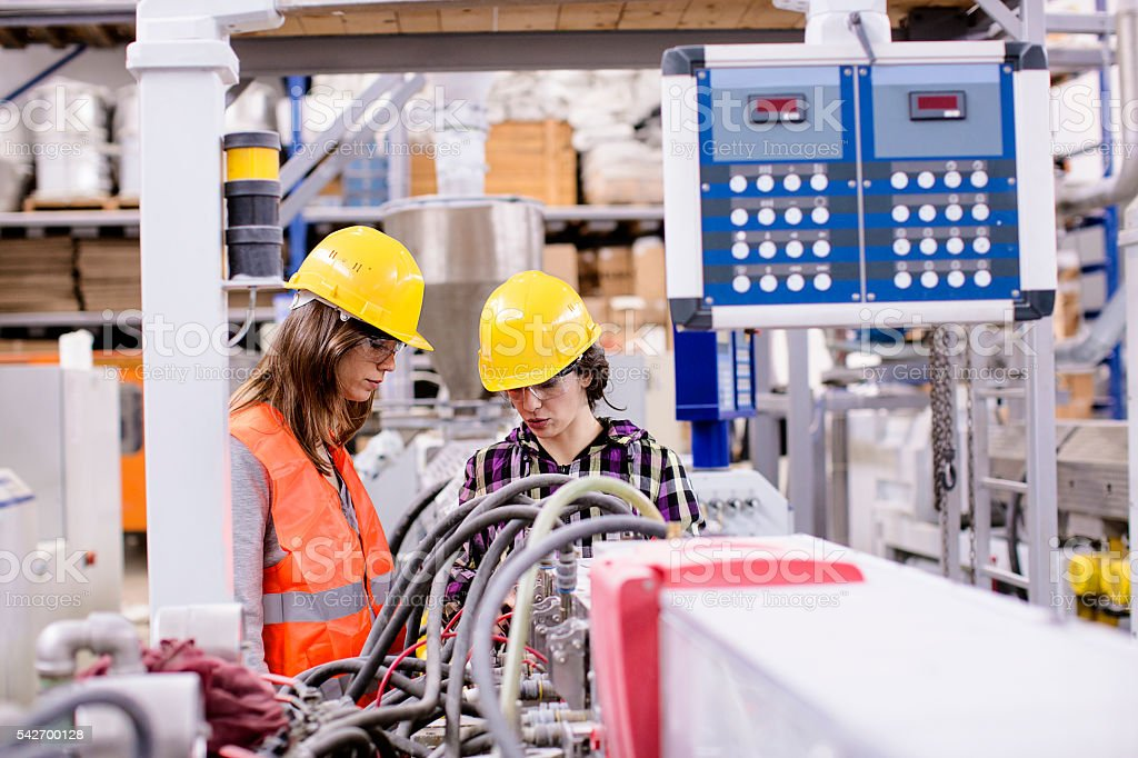 Women engineers in the factory stock photo