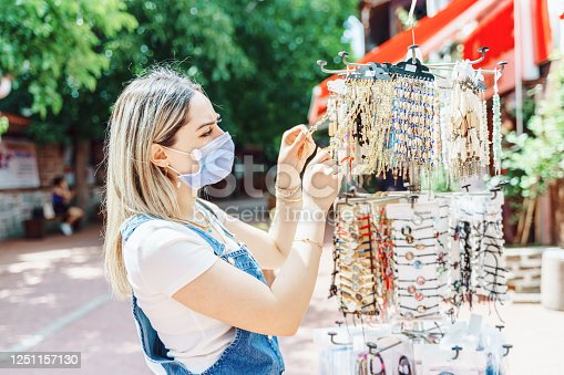 istock women enjoy shopping for jewelry at city street 1251157130
