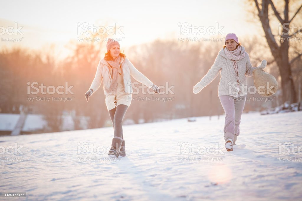 Women Enjoying A Relaxing Winter Walk Stock Photo - Download Image Now - iStock