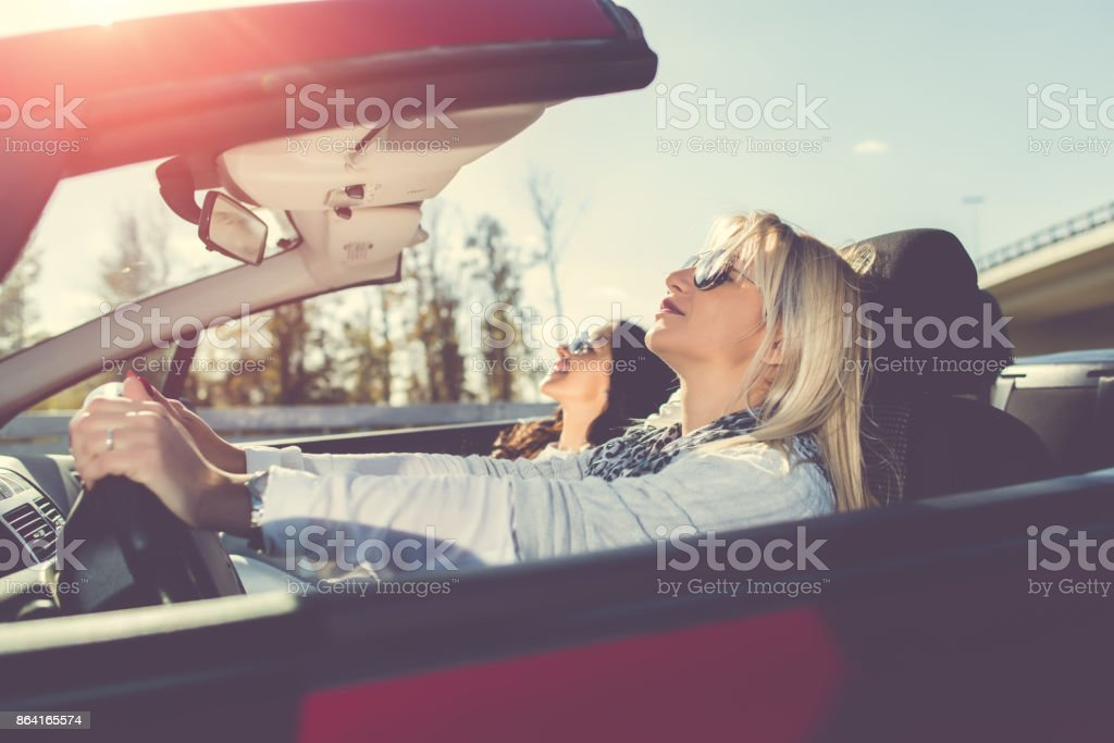 Women enjoying in cabriolet royalty-free stock photo