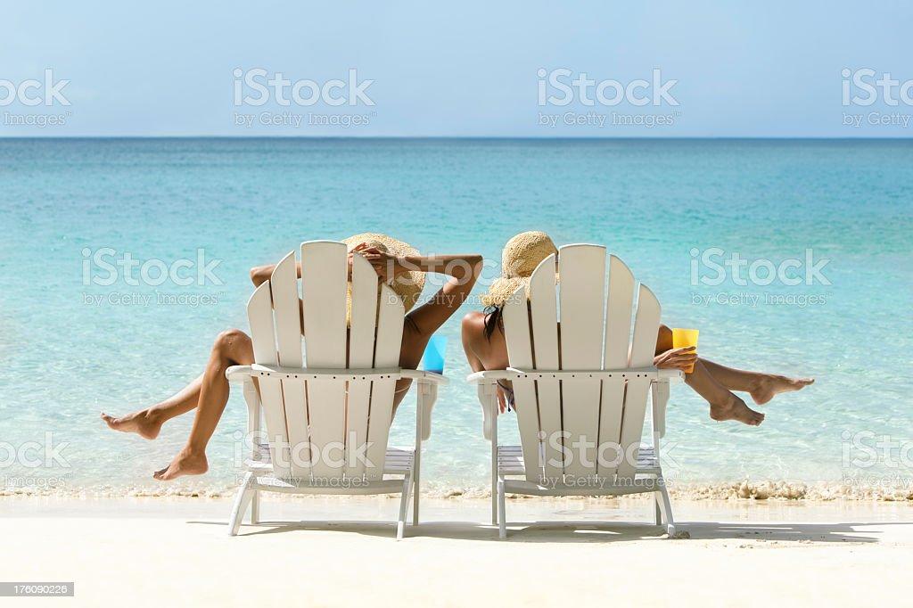 women enjoying the beach stock photo