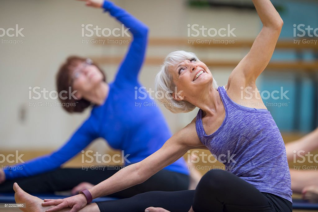 Women Enjoying their Yoga Class stock photo