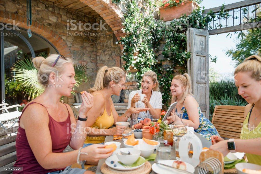 Women Enjoying Villa Breakfast stock photo