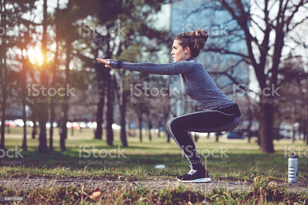 Women exercise at city park stock photo