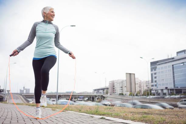 Women exercise in city stock photo