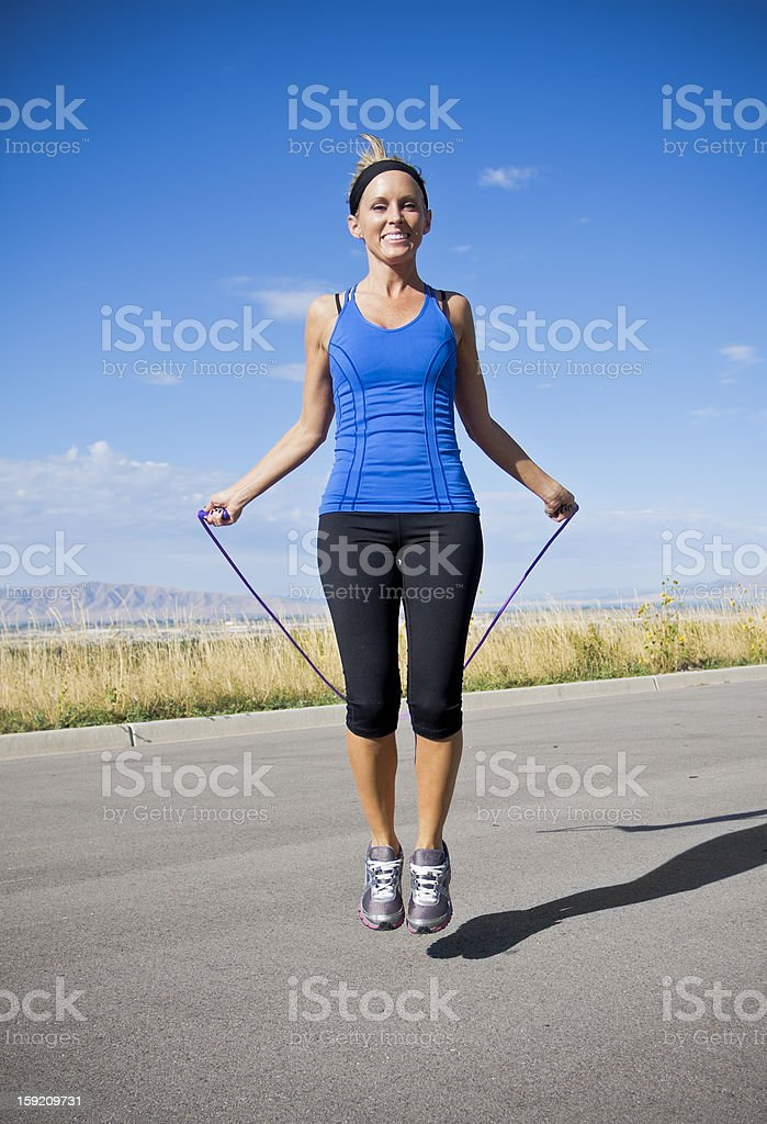 Women Exercising and Jumping Rope stock photo