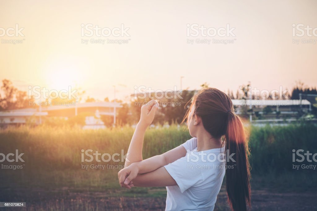 Women exercising in sunny bright light.in park royalty-free stock photo