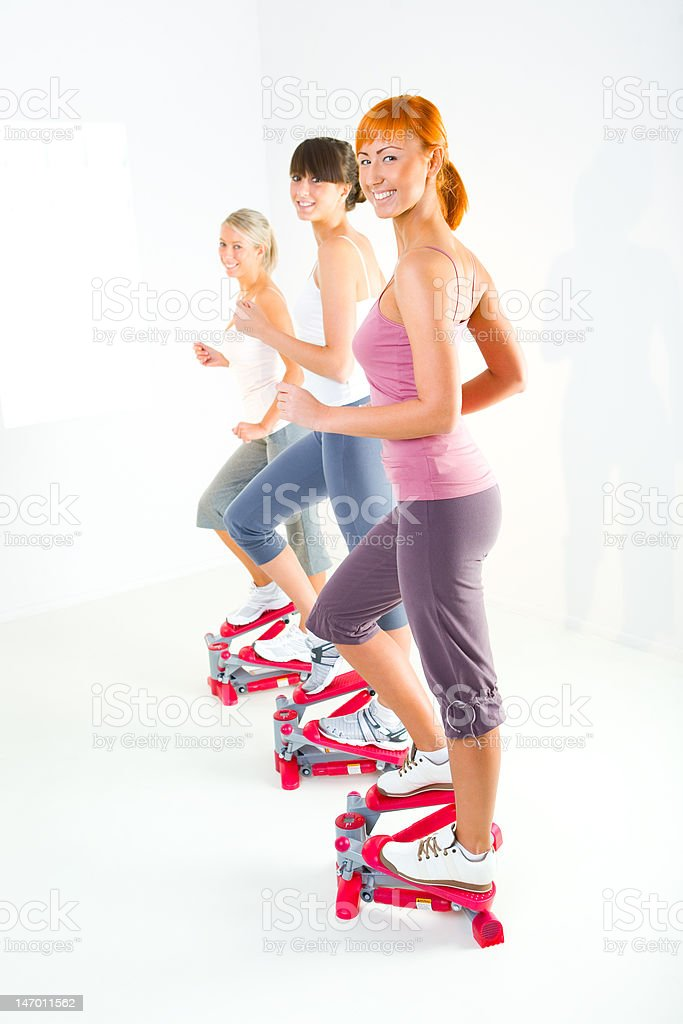 Women exercising on stepping machine royalty-free stock photo