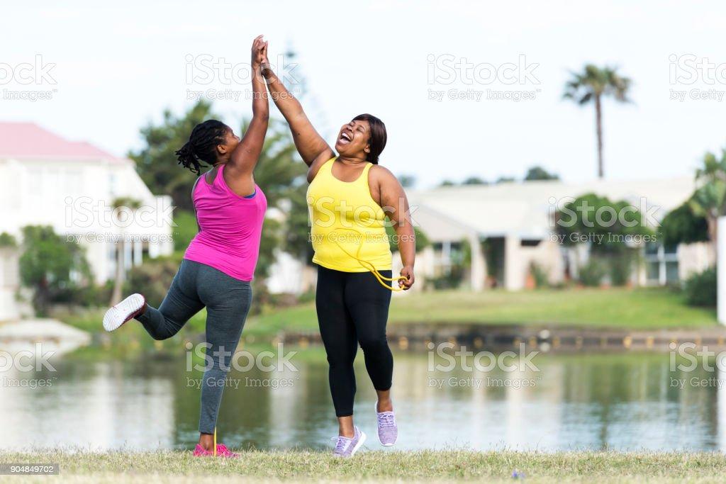 Women exercising outdoors stock photo