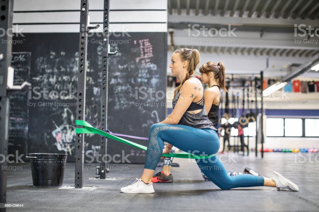 Women exercising with resistance bands in gym stock photo