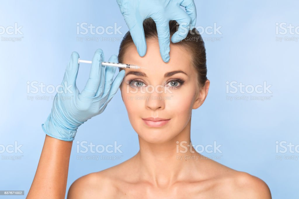 Women face with botox stock photo